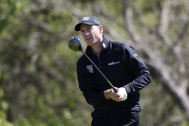 Jim Furyk uses one of his two drivers during the opening round of the Valero Texas Open.