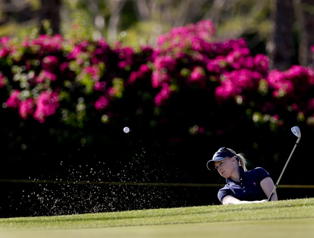 Morgan Pressel hits from a greenside bunker on the 14th hole during the second round of the LPGA Kraft Nabisco Championship.
