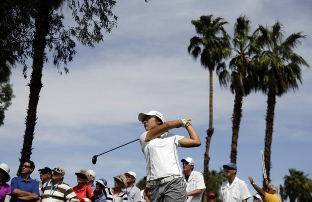 Lydia Ko, of New Zealand, hits on the fifth hole during the second round of the LPGA Kraft Nabisco Championship.