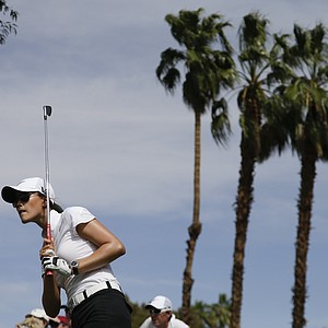 Michelle Wie watches her tee shot on the fifth hole during the second round of the LPGA Kraft Nabisco Championship.