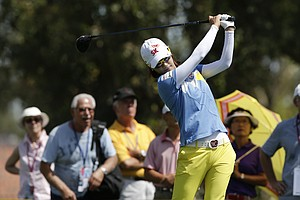 Na Yeon Choi, of South Korea, hits her tee shot on the third hole during the second round of the LPGA Kraft Nabisco Championship.