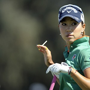 Momoko Ueda, of Japan, waves to the crowd after hitting from the tee on the second hole during the third round of the Kraft.