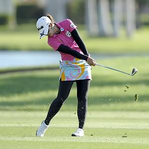 Pornanong Phatlum hits on the 18th hole during the third round of the LPGA Kraft Nabisco Championship.