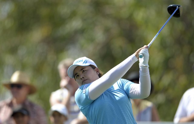 Inbee Park, of South Korea, watches her tee shot on the ninth hole during the third round of the LPGA Kraft Nabisco Championship.
