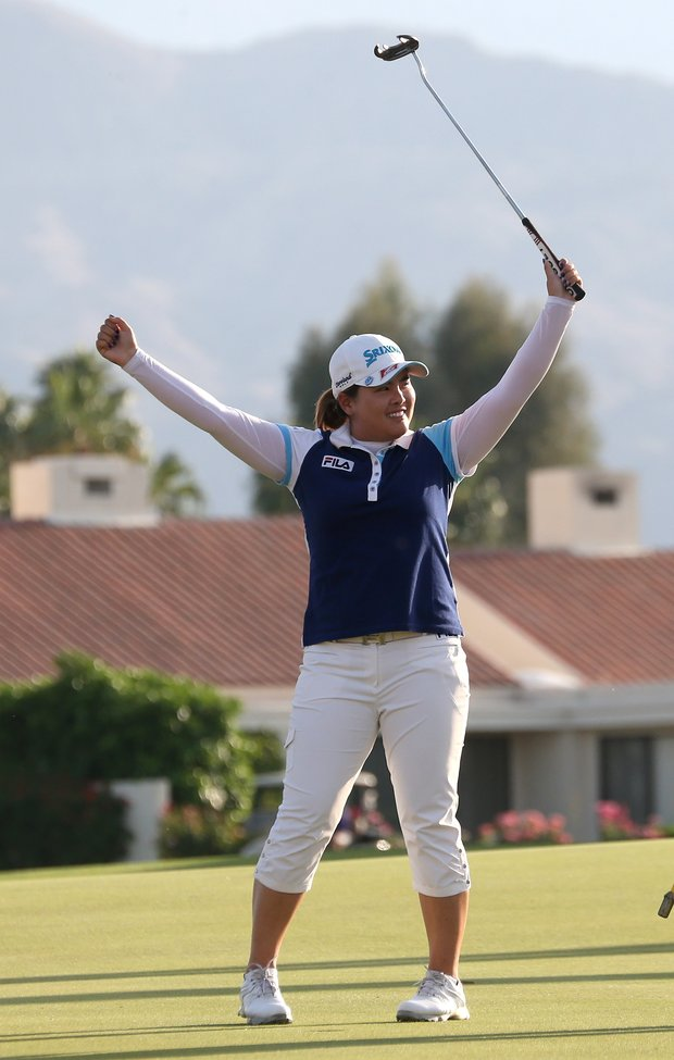 Inbee Park celebrates after making the final putt to win the Kraft Nabisco Championship.