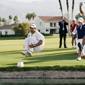 Inbee Park, second from right, of South Korea, celebrates by jumping into Poppy's Pond with caddie Brad Beecher, left, after winning the LPGA Kraft Nabisco Championship.