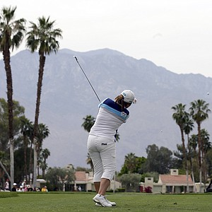 Inbee Park, of South Korea, watches her tee shot on the fifth hole during the final round of the LPGA Kraft Nabisco Championship.