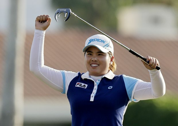 Inbee Park, of South Korea, reacts after winning the LPGA Kraft Nabisco Championship.