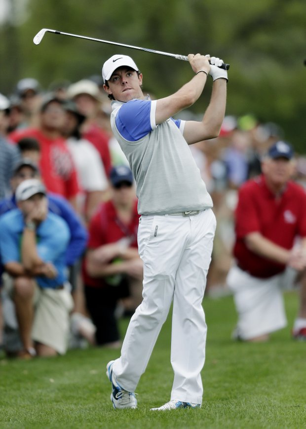 Rory McIlroy watches his shot from the rough on the first hole during the final round of the Texas Open.