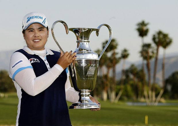 Inbee Park, of South Korea, holds up the trophy after winning the LPGA Kraft Nabisco Championship golf.