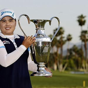 Inbee Park, of South Korea, holds up the trophy after winning the LPGA Kraft Nabisco Championship.