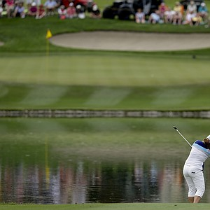 Inbee Park, of South Korea, watches approach shot on the sixth hole during the final round of the LPGA Kraft Nabisco Championship.