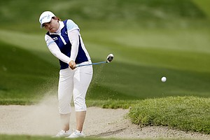 Inbee Park, of South Korea, watches her shot from the fairway bunker on the second hole during the final round of the LPGA Kraft Nabisco Championship.