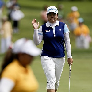 Inbee Park, of South Korea, waves after a birdie as playing partner Lizette Salas on the first hole during the final round of the LPGA Kraft Nabisco Championship.