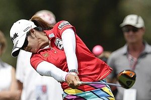 Pornanong Phatlum, of Thailand, hits her tee shot on the second hole during the final round of the LPGA Kraft Nabisco Championship.