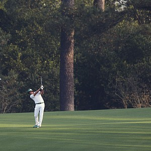 Rickie Fowler hits off the second fairway during a practice round for the Masters on April 8.