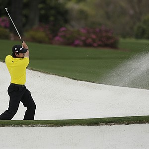 Jason Day, of Australia, hits out of a bunker on the driving range at the Masters.