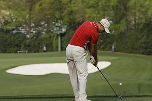 Martin Kaymer, of Germany, tees off the fourth fairway during a practice round for the Masters.