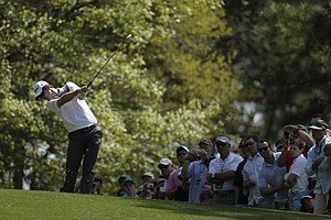 Justin Rose, of England, hits off the fourth fairway during a practice round for the Masters on April 8 in Augusta, Ga.