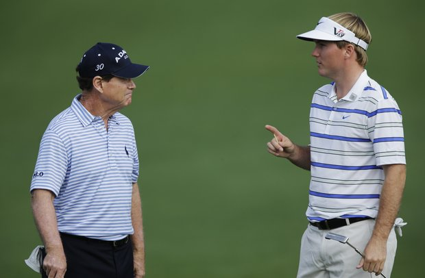 Russell Henley, right, speaks with Tom Watson at the second hole during a practice round for the Masters.