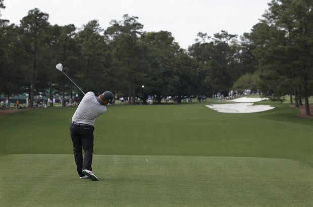 Ryan Moore hits off the first tee during a practice round for the Masters on April 8.