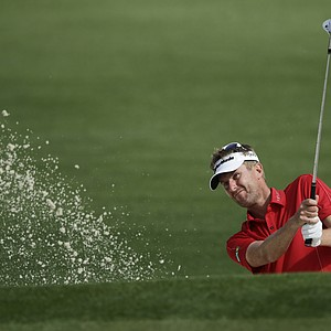 David Lynn, of England, chips to the second green during a practice round for the Masters.