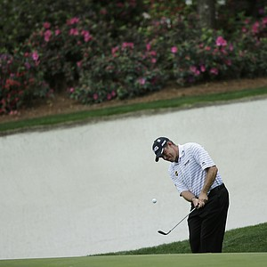 Lee Westwood, of England, chips out of a bunker on the 13th hole during a practice round for the Masters.