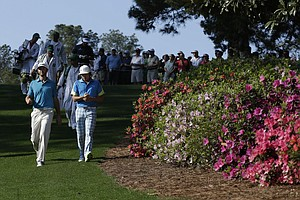 Rickie Fowler, right, and Dustin Johnson walk along the sixth fairway during a practice round Tuesday for the 2013 Masters at Augusta National.