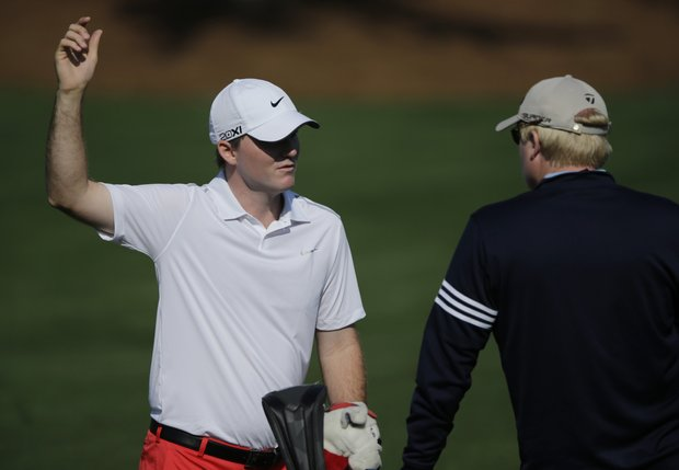 Russell Henley speaks with his coach on the driving range during a practice round Tuesday for the 2013 Masters at Augusta National.