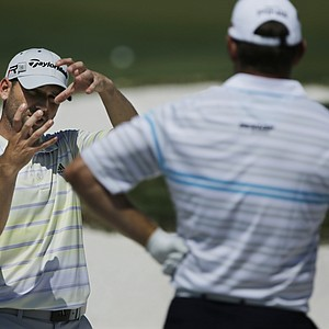 Sergio Garcia, left, talks with Lee Westwood on the driving range Tuesday at Augusta National.