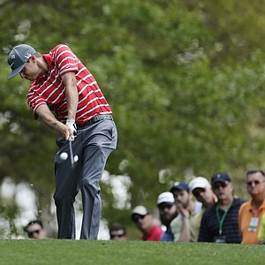 Nick Watney hits from the fourth fairway during a practice round Tuesday for the 2013 Masters at Augusta National.
