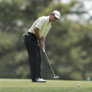 Mike Weir, of Canada, putts on the third hole during a practice round for the Masters on Tuesday.