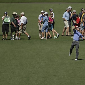 Rory McIlroy throws a ball up the seventh fairway during a practice round Tuesday for the 2013 Masters at Augusta National.