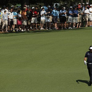 Phil Mickelson walks down the ninth fairway during a practice round Tuesday for the 2013 Masters at Augusta National.