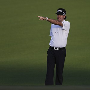 Bubba Watson points back to the first tee from the first fairway during a practice round Tuesday for the 2013 Masters at Augusta National.