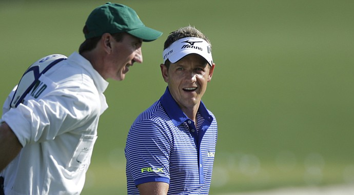 Luke Donald and caddie John McLaren during Tuesday practice round for the 2013 Masters in Augusta, Ga.