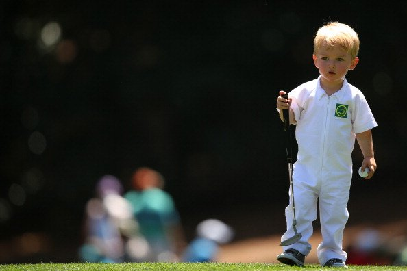 John Merrick of the United States' son, Chase, during the Par-3 Contest at Augusta National Golf Club.