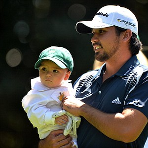 Jason Day of Australia with his daughter Dash James Day during the Par-3 Contest on Wednesday.