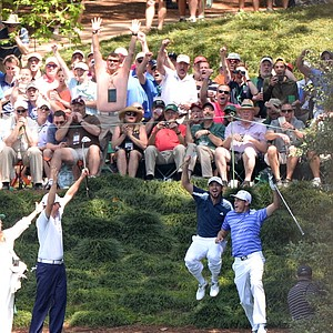 Nick Watney of the United States celebrates with Jason Day of Australia and Webb Simpson of the United States after getting a hole in one on the ninth hole during the Par-3 Contest at Augusta National.