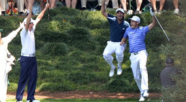 Nick Watney celebrates with Jason Day and Webb Simpson after getting a hole in one on the ninth hole during the Par-3 Contest at Augusta National.