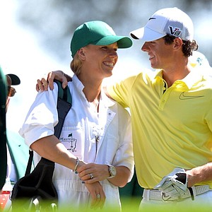 Rory McIlroy of Northern Ireland and his girlfriend tennis star Caroline Wozniacki speak as they play in the Par 3 Contest at the Masters at Augusta National Golf Club.