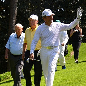 Arnold Palmer of the U.S., Jack Nicklaus of the U.S. and Gary Player of South Africa walk the fairway during the Par 3 Contest at the 77th Masters.