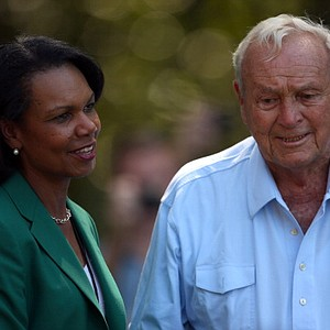Former Secretary of State and Augusta National Golf Club member, Condoleezza Rice, talks with Arnold Palmer of the United States during the Par 3 Contest at Augusta National.