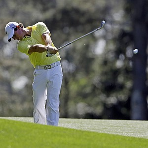 Rory McIlroy, of Northern Ireland, hits off the 15th fairway during a practice round for the Masters at Augusta National.