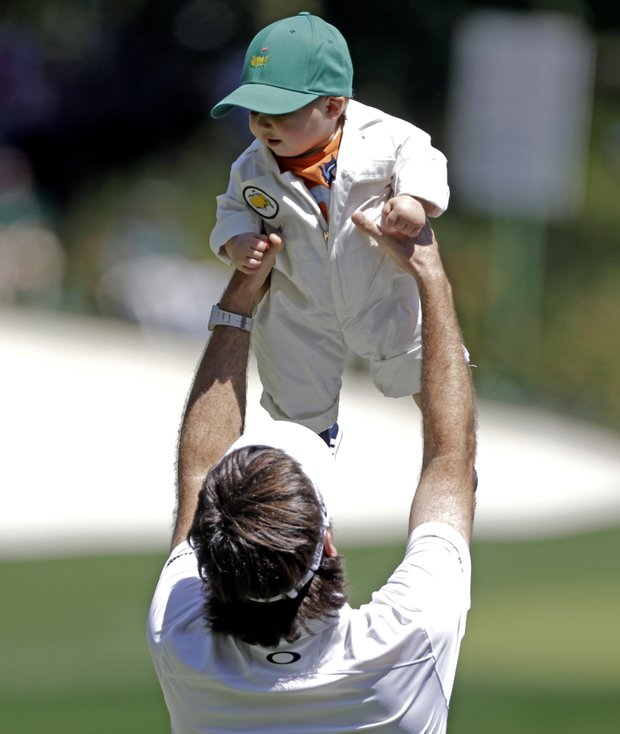 Bubba Watson lifts his son Caleb during the Par-3 Contest before the Masters on Wednesday.