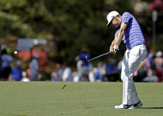 Nick Watney hits off the 14th fairway during a practice round for the Masters.