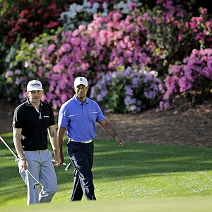 Tiger Woods, right, walks to the 13th green with Keegan Bradley during a practice round for the Masters on Wednesday.