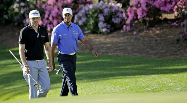 Tiger Woods (right) walks to the 13th green with Keegan Bradley during a practice round on Wednesday at the Masters.
