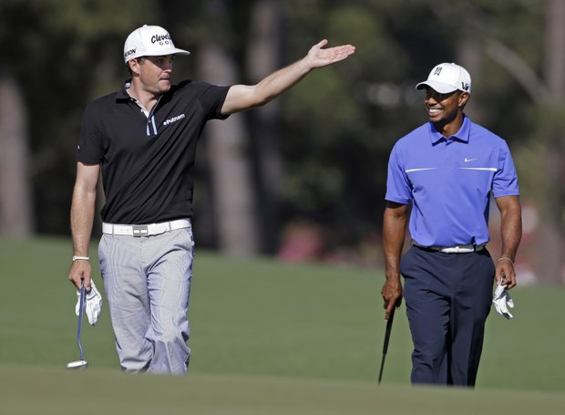 Keegan Bradley, left, talks to Tiger Woods on the 17th fairway during a practice round for the Masters.