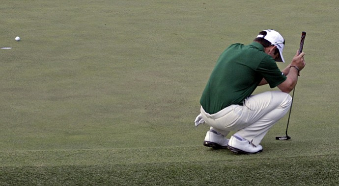 Louis Oosthuizen reacts after missing a putt on No. 10 during the 2012 Masters playoff that saw Bubba Watson win after a famed wedge shot from the trees.
